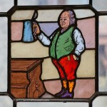 A photo of the stained glass window of Ben Franklin