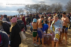 People trying to dry and get warm after jumping in Lake Michigan Polar Bear Event