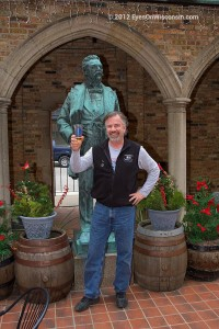 A photo of the owner of the Best Place and the Captain Pabst statue