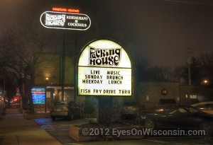 A night photo of The Packing House sign