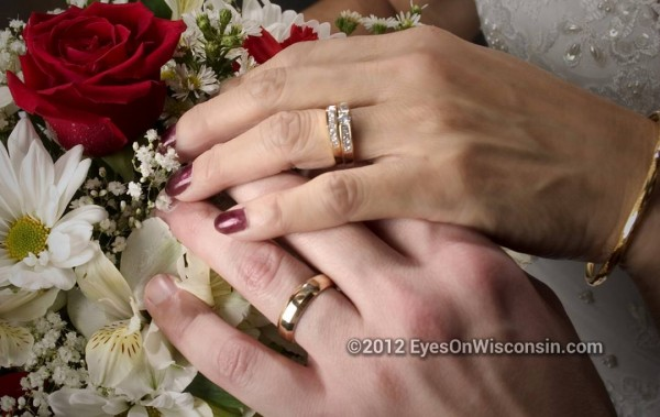 Photo of wedding rings and bouquet