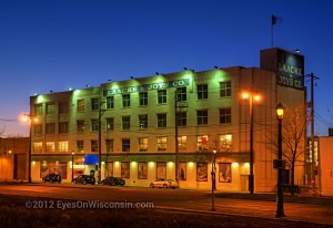 A night photo of the Laacke and Joy's building