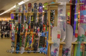 A photo of some of the snowboards