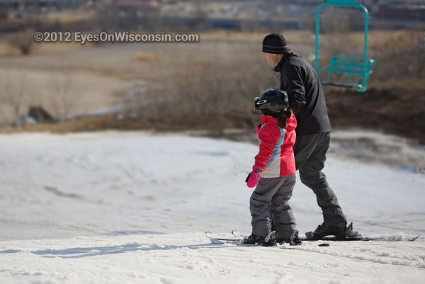 A father and son skiing at Crystal Ridge ski hill