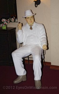 A photo of artificial man in a white suite