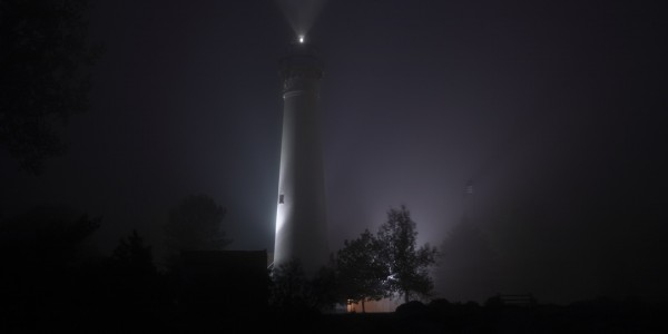 A photo of the Wind Point lighthouse in the fog