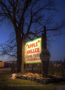 A night photo of the Apple Holler Family Farm sign
