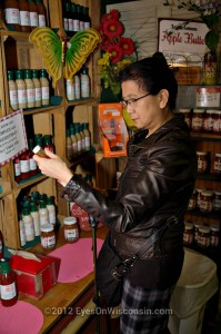 A photo of a woman looking at Apple Holler's jam selection