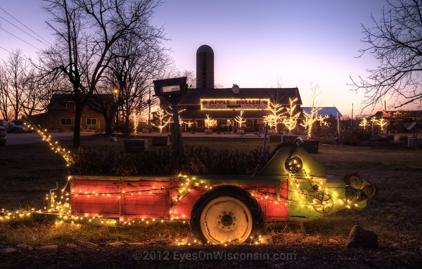 A photo of farm machinery with Christmas lights at Apple Holler
